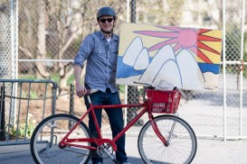 New York Bicycle Portrait: Jeremy carrying a painting home on his bike