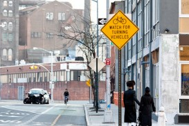 A Hasidic Jewish family walks along the Kent Ave bike lane in Williamsburg, Brooklyn.