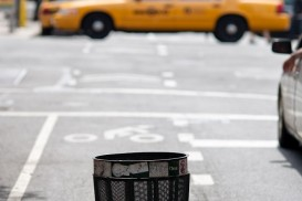 Trash can in a bike lane pothole